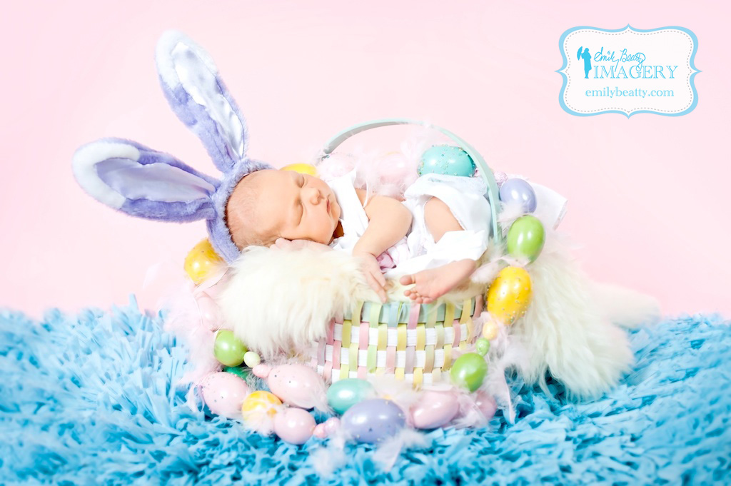 5 day old baby girl in Easter basket