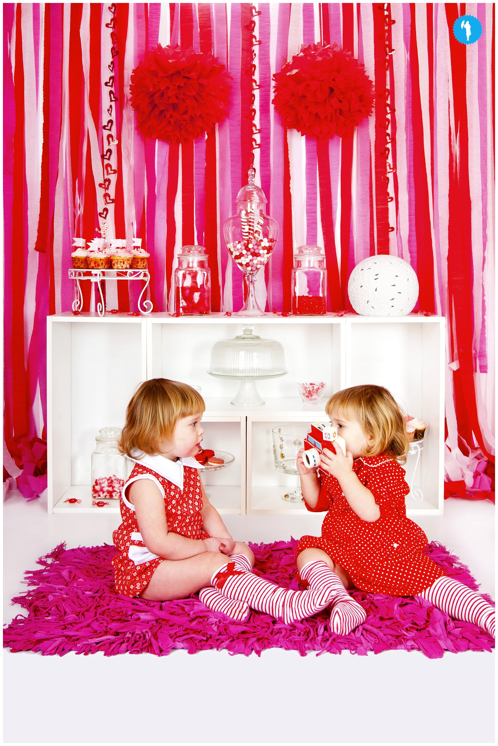 Twins with a camera, creative portrait by Emily Beatty.