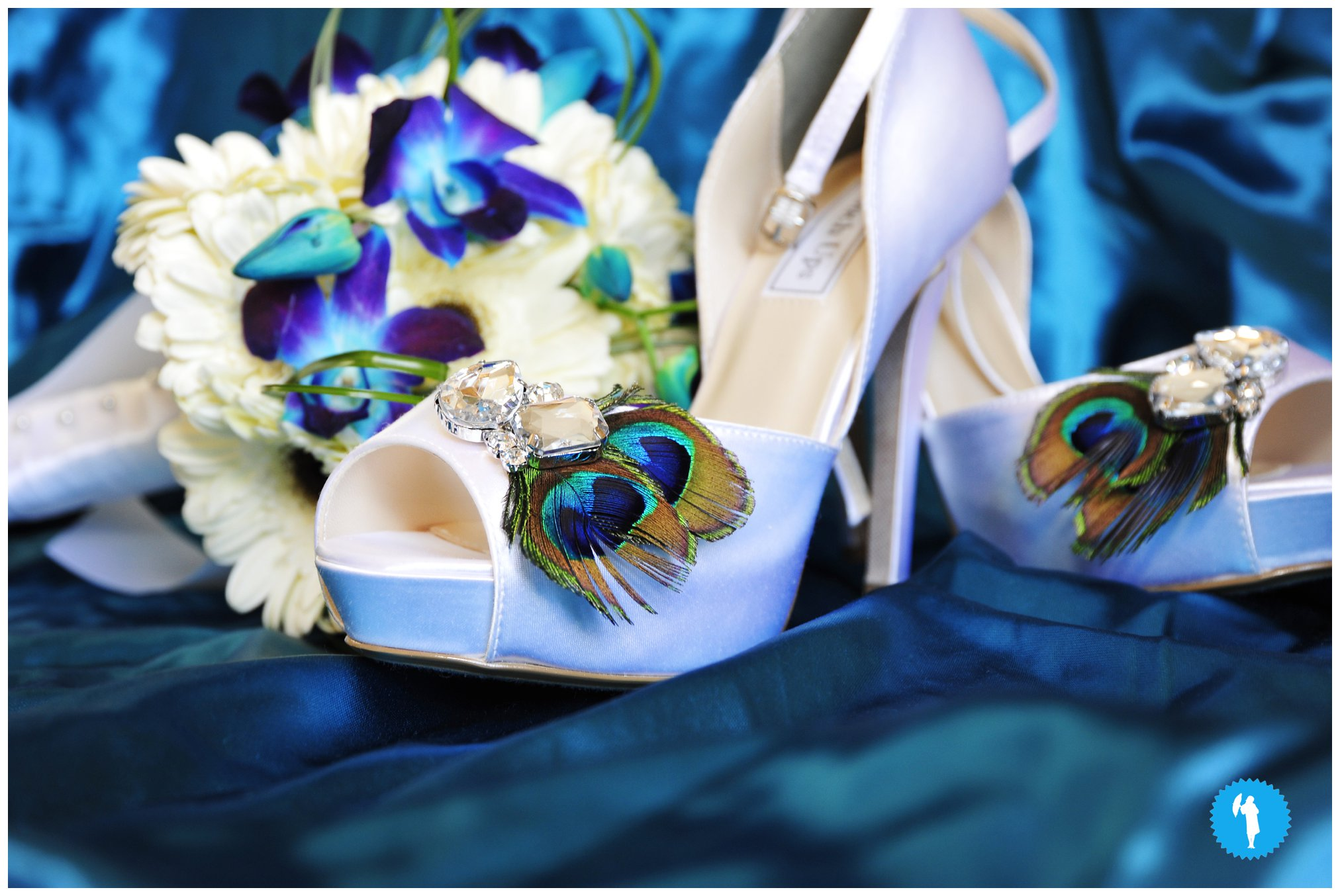 Wedding blue shoes. Peacock feather accessories.